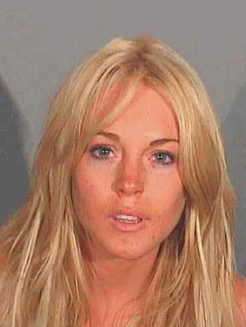 Actress Lindsay Lohan is pictured in this police booking photograph released July 24, 2007. Lohan was arrested in the Los Angeles area early on July 24, 2007 on suspicion of drunken driving and cocaine possession, days after she completed a 45-day rehabilitation program, authorities said. Photo: HO, REUTERS / X80001