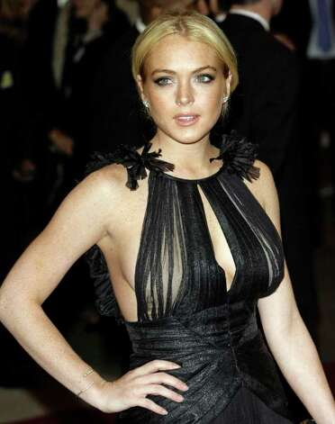 ** FILE ** Lindsay Lohan arrives at the Metropolitan Museum of Art Costume Institute Gala in New York, in this  May, 7, 2007 file photo. Lohan was arrested on suspicion of driving under the influence Saturday, May 26, 2007, after her convertible struck a curb, and investigators found what they believe is cocaine at the scene, police said. Photo: Stuart Ramson, AP / AP