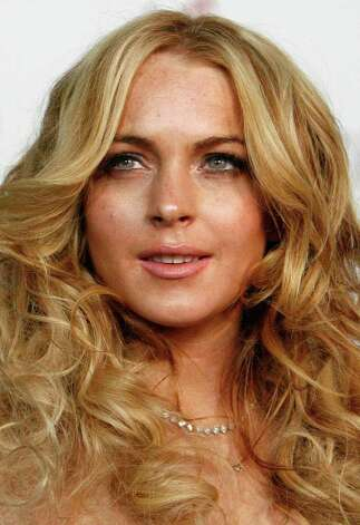 Actress Lindsay Lohan arrives at a party in Los Angeles, California in this April 26, 2007 file photo. Lohan has topped Maxim magazine's list of the 100 hottest women in the world -- while her celebrity late-night party friends Britney Spears and Paris Hilton failed to make the cut on May 15, 2007.   REUTERS/Mario Anzuoni/Files  (UNITED STATES) Photo: MARIO ANZUONI, REUTERS / X90045