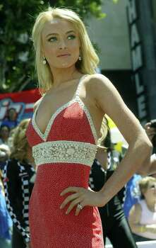 "Actress Lindsay Lohan poses for photographers at the premiere for ""Herbie: Fully Loaded"" Sunday, June 19, 2005, in the Hollywood section of Los Angeles. The movie opens Wednesday, June 22, 2005. Photo: RIC FRANCIS, AP / AP"