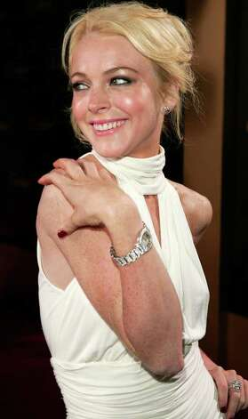 **FILE**  Lindsay Lohan poses at Cartier jewelers in Beverly Hills, Calif., in this Monday, May 9, 2005 file photo as they celebrate 25 years in Beverly Hills, Calif. Recent photos show Lindsay Lohan looking startlingly thin.  The 18-year-old actress attributes her slimmer figure to a new exercise regimen. Photo: CHRIS POLK, AP / AP