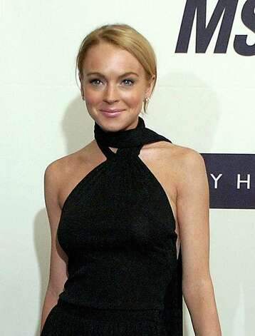 "Lindsay Lohan poses for photographers on the red carpet before the annual Race to Erase MS benefit gala, Friday, April 22, 2005, in Los Angeles. Lohan made Teen People's list of the ""25 Hottest Stars Under 25,""which also includes Alicia Keys, Ciara, Jessica and Ashlee Simpson, Jesse McCartney and Justin Timberlake. The list is featured in the magazine's latest issue, on newsstands Friday, May 6, 2005. Photo: RENE MACURA, AP / AP"