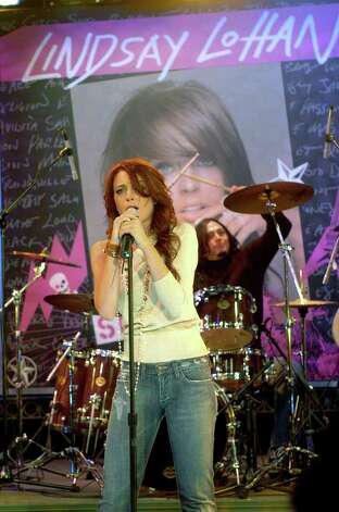 "In this photo supplied by ABC,  teen queen Lindsay Lohan makes her live singing debut on ABC's ""Good Morning America"" in New York Monday Dec. 6, 2004. The actress' debut album, ""Speak,"" comes out Tuesday. Photo: IDA MAE ASTUTE, AP / ABC, INC."