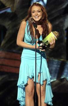 Actress Lindsay Lohan accepts the award for Breakthrough Female during the MTV Movie Awards on Saturday, June 5, 2004, in Culver City, Calif. The show will air on Thursday, June 10. Photo: CHRIS PIZZELLO, AP / AP