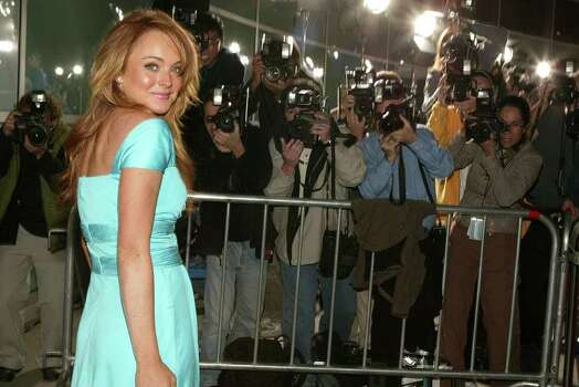 "Lindsay Lohan arrives at the premiere of her new film ""Mean Girls"" at the Cinerama Dome in Los Angeles on Monday, April 19, 2004. Photo: CHRIS POLK, AP / CHRIS POLK"