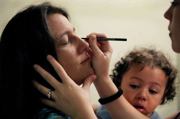 Brenda Willborn, left, has her make up applied by her daughter Mandy Willborn, right, before Brenda and Marion Wright exchanged wedding vows at the Chapel of Hope at Haven, Saturday, Dec. 4, 2010.  Brenda is holding her grandson Draven Gonzales.  Brenda and Marion met, and are residents at Haven for Hope.  Photo: BOB OWEN, SAN ANTONIO EXPRESS-NEWS / SAN ANTONIO EXPRESS-NEWS