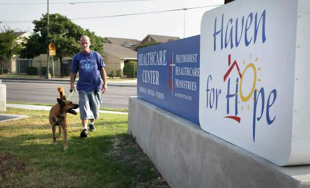 Marion Wright walks his dog Rudy back to Haven for Hope, after a morning outing, Wednesday,  Aug 25, 2010.  Photo: BOB OWEN, SAN ANTONIO EXPRESS-NEWS / SAN ANTONIO EXPRESS-NEWS