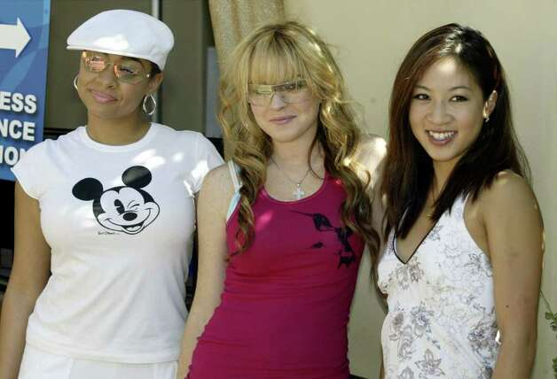 Actors Raven (L), Lindsay Lohan (C) and figure skater/commentator Michelle Kwan attend the ABC Primetime Preview Weekend on September 6, 2003 at Disney's California Adventure in Anaheim, California. Photo: Doug Benc, Getty Images / 2003 Getty Images