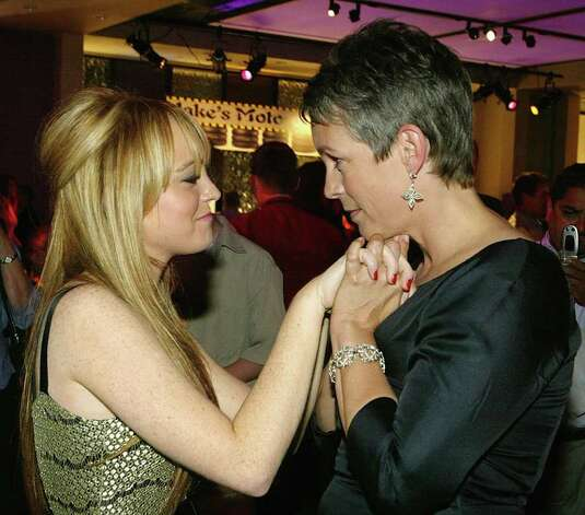 HOLLYWOOD, CA - AUGUST 4:  (US TABS AND HOLLYWOOD REPORTER OUT) Jamie Lee Curtis (R) takes Lindsay Lohan's hands as she talks to her during an after party at the Annex following the premiere of the Disney film Freaky Friday August 4, 2003 in Hollywood, CA. Photo: Carlo Allegri, Getty Images / 2003 Getty Images