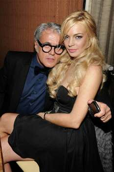 WEST HOLLYWOOD, CA - FEBRUARY 04:  Designer Giuseppe Zanotti (L) and actress Lindsay Lohan attend the Giuseppe Zanotti Design Beverly Hills Store Opening dinner held at BOA Sunset on February 4, 2011 in West Hollywood, California.  (Photo by John Sciulli/Getty Images for Giuseppe Zanotti Design) *** Local Caption *** Giuseppe Zanotti;Lindsay Lohan Photo: John Sciulli, Getty Images For Giuseppe Zanott / 2011 Getty Images