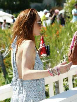 MALIBU, CA - JULY 11:  Actress Lindsay Lohan attends the Lia Sophia Clam Bake at a private residence on July 11, 2009 in Malibu, California.  (Photo by Michael Buckner/Getty Images) *** Local Caption *** Lindsay Lohan Photo: Michael Buckner, Getty Images / 2009 Getty Images