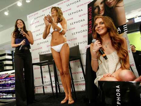 SANTA MONICA, CA - APRIL 30:  Creator of Sevin Nyne Lorit Simon (L) and actress Lindsay Lohan (R) speak at the launch of Sevin Nyne By Lindsay Lohan held at Sephora on April 30, 2009 in Santa Monica, California.  (Photo by Michael Buckner/Getty Images) *** Local Caption *** Lorit Simon;Lindsay Lohan Photo: Michael Buckner, Getty Images / 2009 Getty Images