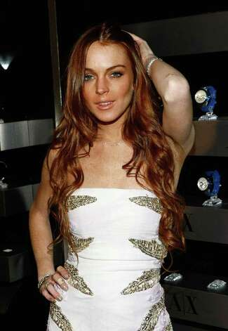 LOS ANGELES, CA - APRIL 15:  Actress Lindsay Lohan arrives at the launch of A/X Watches at the SLS Hotel on April 15, 2009 in Los Angeles, California.  (Photo by Michael Buckner/Getty Images) *** Local Caption *** Lindsay Lohan Photo: Michael Buckner, Getty Images / 2009 Getty Images