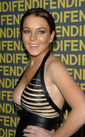 BEVERLY HILLS, CA - FEBRUARY 13:  Actor Lindsay Lohan attends the Fendi celebration of the redesign of its Rodeo Drive flagship store at the Fendi store on February 13, 2008 in Beverly Hills, California.  (Photo by Stephen Shugerman/Getty Images) *** Local Caption *** Lindsay Lohan Photo: Stephen Shugerman, Getty Images / 2008 Getty Images