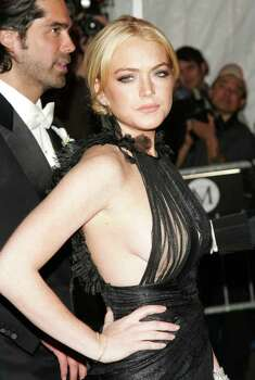 "NEW YORK - MAY 07:  Actress Lindsay Lohan attends the Metropolitan Museum of Art Costume Institute Benefit Gala ""Poiret: King Of Fashion"" at the Metropolitan Museum of Art on May 7, 2007 in New York City.  (Photo by Evan Agostini/Getty Images) *** Local Caption *** Lindsay Lohan Photo: Evan Agostini, Getty Images / 2007 Getty Images"