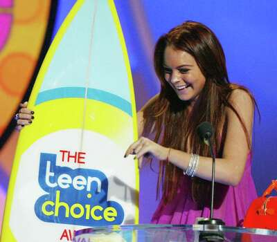 "UNIVERSAL CITY, CA - AUGUST 8:  Winner of 4 ""Choice"" awards, actress Lindsay Lohan laughs on stage at The 2004 Teen Choice Awards held on August 8, 2004 at Universal Amphitheater, in Universal City, California. Photo: Kevin Winter, Getty Images / 2004 Getty Images"