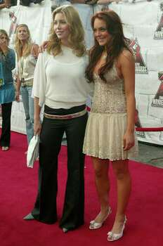 CULVER CITY, CA - JUNE 5:    Actors Jessica Biel and Lindsay Lohan arrive to the 2004 MTV Movie Awards at the Sony Pictures Studios on June 5, 2004 in Culver City, California.  The 2004  MTV Movie Awards will air on the MTV Network June 10, 2004 9 PM (ET/PT). Photo: Frank Micelotta, Getty Images / 2004 Getty Images