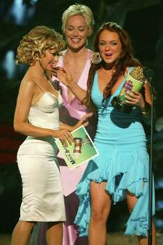 "CULVER CITY, CA - JUNE 5:   (U.S. TABLOIDS OUT)   Actress Sharon Stone and singer Christina Aguilera present the award for ""BreakThrough Female"" to actress Lindsay Lohan on stage at the 2004 MTV Movie Awards at the Sony Pictures Studios on June 5, 2004 in Culver City, California.  The 2004  MTV Movie Awards will air on the MTV Network June 10, 2004 9 PM (ET/PT). Photo: Kevin Winter, Getty Images / 2004 Getty Images"