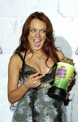 "CULVER CITY, CA - JUNE 5:    Actress Lindsay Lohan, winner of ""Breakthrough Female"" poses in the pressroom at the 2004 MTV Movie Awards at the Sony Pictures Studios on June 5, 2004 in Culver City, California.  The 2004  MTV Movie Awards will air on the MTV Network June 10, 2004 9 PM (ET/PT). Photo: Frazer Harrison, Getty Images / 2004 Getty Images"