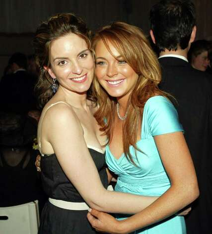 "LOS ANGELES - APRIL 19:  Actress Tina Fey (L) and actress Lindsay Lohan (R) hug at the after-party for Paramount's ""Mean Girls"" at the Cinerama Dome Theater on April 19, 2004 in Los Angeles, California. Photo: Kevin Winter, Getty Images / 2004 Getty Images"