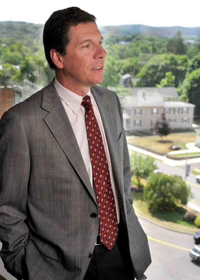 John Murphy, M.D., president and CEO of Danbury Hospital, looks out the window of the presidents office. Photo: File Photo/ Michael Duffy, File Photo / The News-Times File Photo