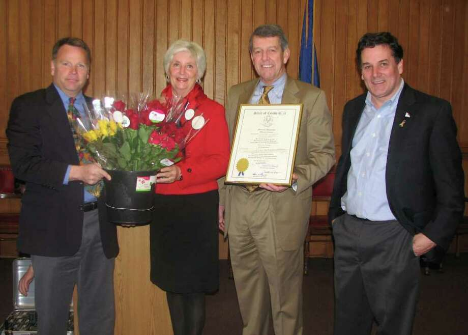 Roses for Autism was named Connecticut, 2011 Business of the Year by the Connecticut General Assembly on April 4. Roses for Autism is based at Pinchbeck Rose Farm in Guilford, and is the first business endeavor of a nonprofit founded by Ability Beyond Disability. Shown from left to right are Tom Pinchbeck, State Rep. Patricia Widlitz, Tom Fanning and Jim Lyman. Photo: Contributed Photo / The News-Times Contributed
