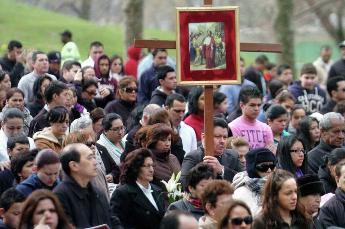 Parishioners and local clergy participate in the Stations of the Cross from Cummings Park to St. Benedict-Our Lady of Montserrat Church on Good Friday in Stamford, Conn. on Friday April 22, 2011.