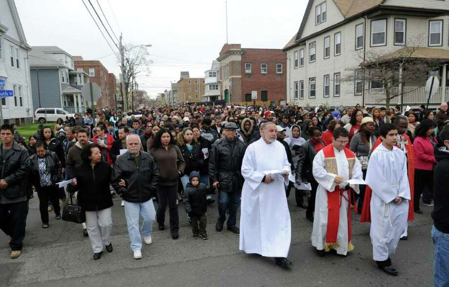 Parishioners and clergy from St. Charles Borromeo Roman Catholic Church take part in a procession through the East Side of Bridgeport, Conn. on Good Friday, April 22, 2011. Photo: Autumn Driscoll / Connecticut Post