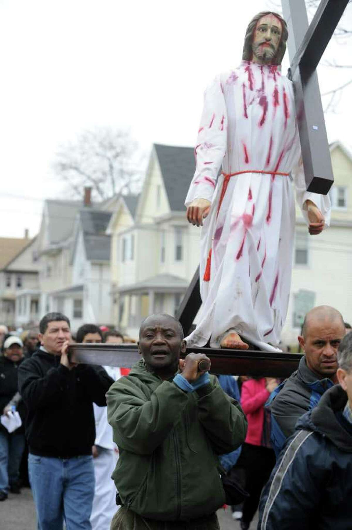 Parishioners and clergy from St. Charles Borromeo Roman Catholic Church take part in a procession through the East Side of Bridgeport, Conn. on Good Friday, April 22, 2011.