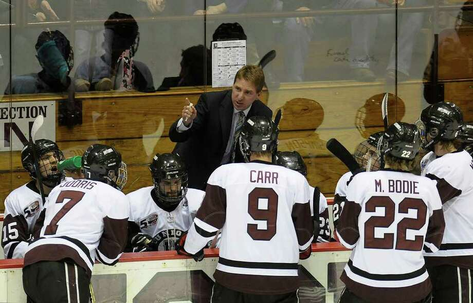 Union head coach Nate Leaman coaches his team against Colgate during the first period of Game 2 of an ECAC quarterfinals playoff series hockey game at Union College in Schenectady, N.Y., Saturday March 12, 2011. (Hans Pennink / Special to the Times Union) College Sports Photo: Hans Pennink / 00012321B