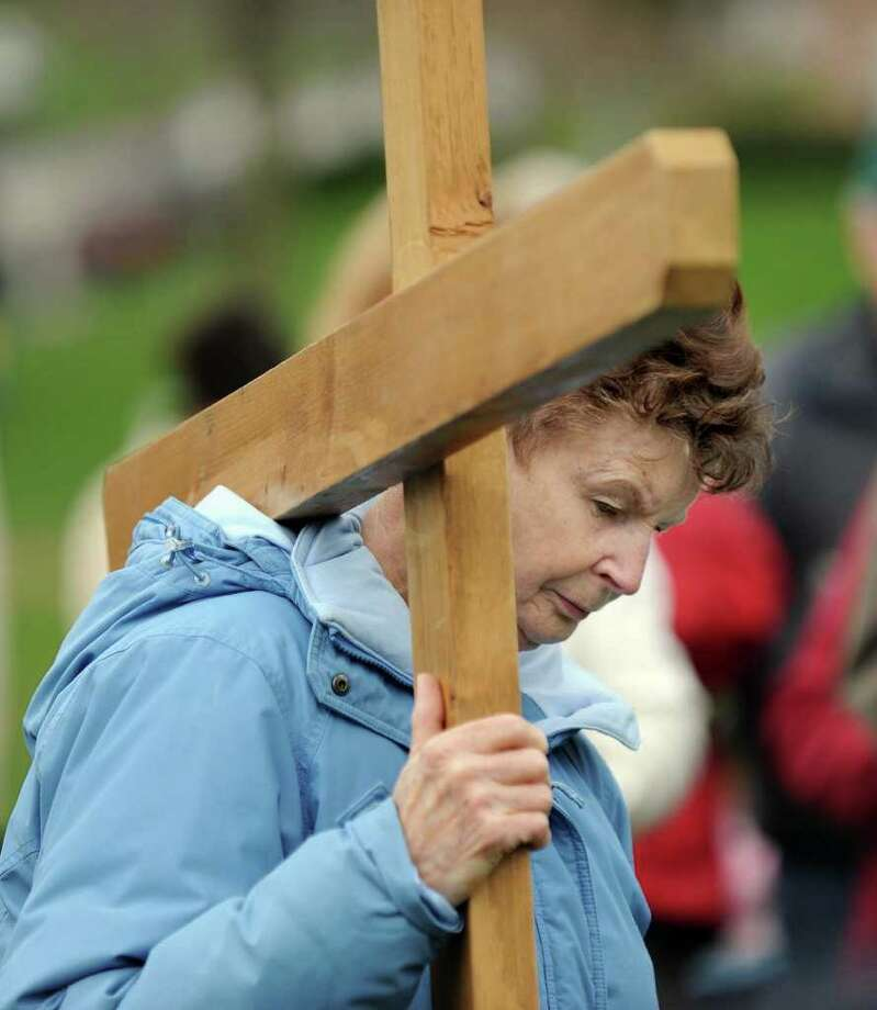 Mary Miller, of New Milford, reflects on the message of Good Friday during a Stations of the Cross walk around the New Milford Green. A different participant carried the cross for each of the stations. Photo taken Friday, April 23, 2011. Photo: Carol Kaliff / The News-Times