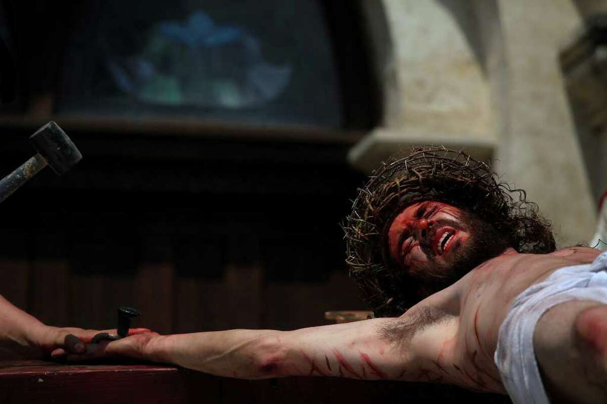 Jesus, played by Bruno Horwath, is nailed to the Cross in front of San Fernando Cathedral during the Passion Play on Friday, April 22, 2011. LISA KRANTZ/lkrantz@express-news.net