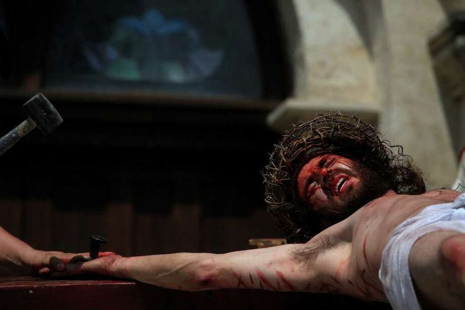 Jesus, played by Bruno Horwath, is nailed to the Cross in front of San Fernando Cathedral during the Passion Play on Friday, April 22, 2011. LISA KRANTZ/lkrantz@express-news.net Photo: LISA KRANTZ / SAN ANTONIO EXPRESS-NEWS