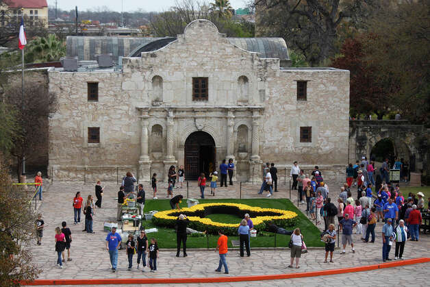 The Roses of Remembrance wreath adorns the lawn of the Alamo. LISA KRANTZ / EXPRESS-NEWS