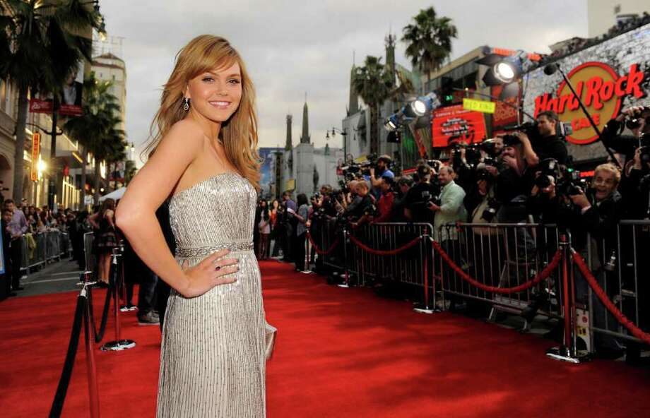 """Aimee Teegarden, a cast member in """"Prom,"""" poses on the red carpet at the premiere of the film, Thursday, April 21, 2011, in Los Angeles. (AP Photo/Chris Pizzello) Photo: Chris Pizzello"""