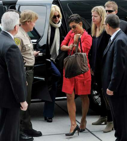 Actress Lindsay Lohan, center, arrives with her lawyer, Shawn Chapman Holley for a preliminary hearing, Friday, April 22, 2011, at LAX Courthouse in Los Angeles. Lohan is in court for a hearing on a felony grand theft charge involving a necklace reported stolen by an upscale jewelry store. (AP Photo/Chris Pizzello) Photo: Chris Pizzello