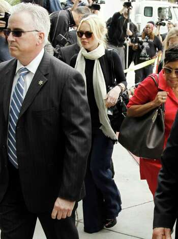 Actress Lindsay Lohan, center, arrives at the LAX Airport Courthouse in Los Angeles, Friday, April 22, 2011. Lohan is in court for a preliminary hearing on a felony grand theft charge involving a necklace reported stolen by an upscale jewelry store. (AP Photo/Matt Sayles) Photo: Matt Sayles