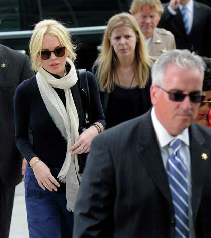 Lindsay Lohan, left, arrives for a preliminary hearing, Friday, April 22, 2011, at LAX Courthouse in Los Angeles. Lohan is in court for a hearing on a felony grand theft charge involving a necklace reported stolen by an upscale jewelry store. (AP Photo/Chris Pizzello) Photo: Chris Pizzello