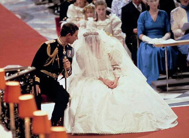 Prince Charles and Lady Diana Spencer are shown at their wedding at St