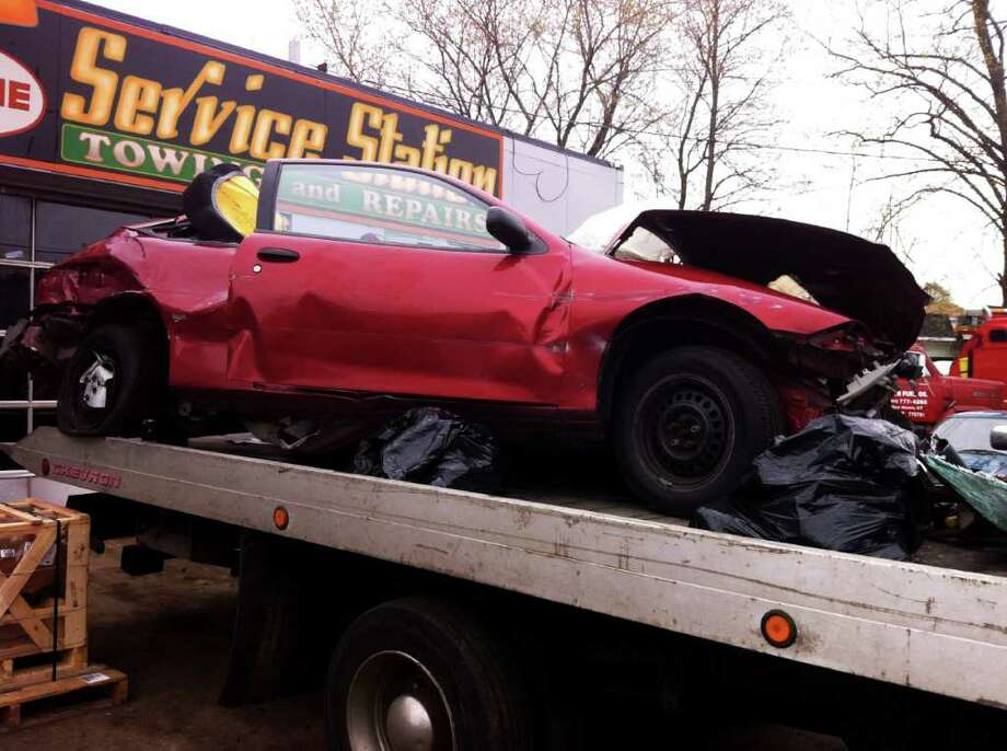The 1999 Chevrolet Cavalier driven by Tracy Brancucio of Derby, who is in critical condition Friday morning at Bridgeport Hospital after an early morning four-vehicle crash on Route 8 in Ansonia, near Seymour. State police said Brancucio lost control of her vehicle and was then struck by three other vehicles while driving just south of Exit 19 just before 1:30 a.m. Photo: Autumn Driscoll / Connecticut Post