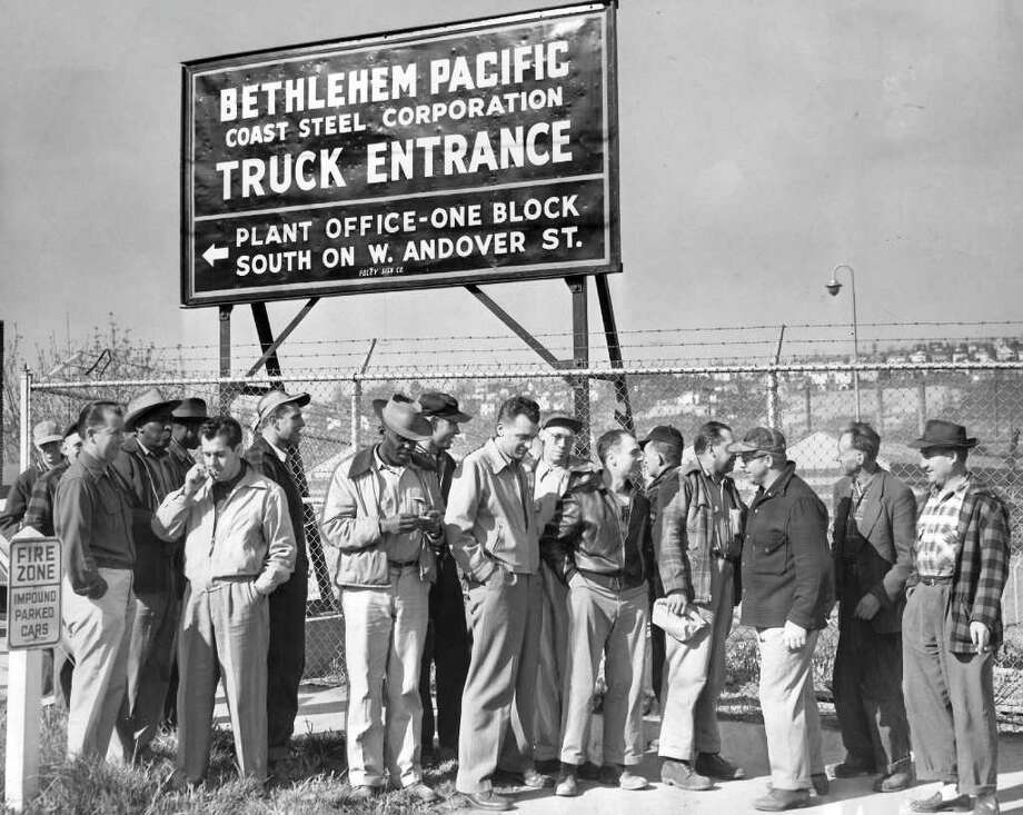 The April 1952 photo caption read: At the Bethlehem Pacific Coast Steel Corp. Seattle rolling mill, 26th Ave. S. W. and W. Andover St., workmen stand idly outside the gates Wednesday morning, when company refused to admit workers pending clarification of national steel situation. Steel workers reported for the 7 a.m. shift here and at the company's fabricating plant, 8501 E. Marginal Way. Photo: Seattlepi.com File