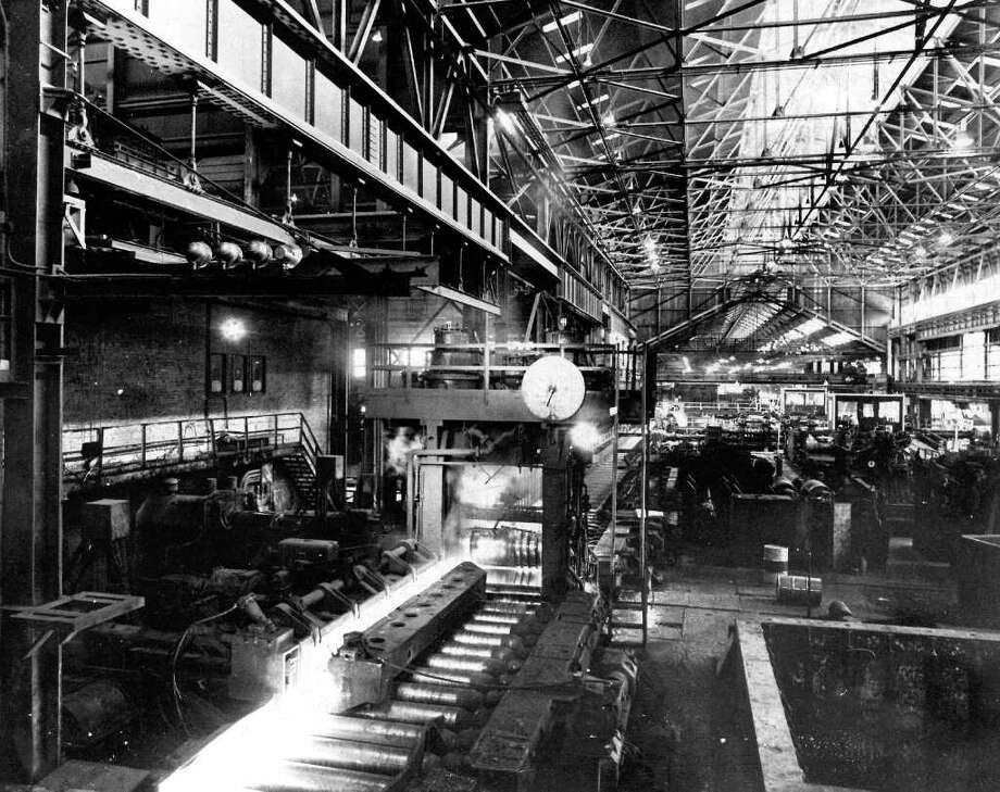 The Aug. 1975 caption read: One of Bethelehems three rolling mills where red hot ingots are transformed into long bars. Photo: Seattlepi.com File