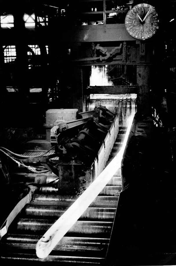 Rolling mill rolls a glowing steel bar into a specific shape at Bethlehem's Seattle plant. April 29, 1979. Photo: Seattlepi.com File