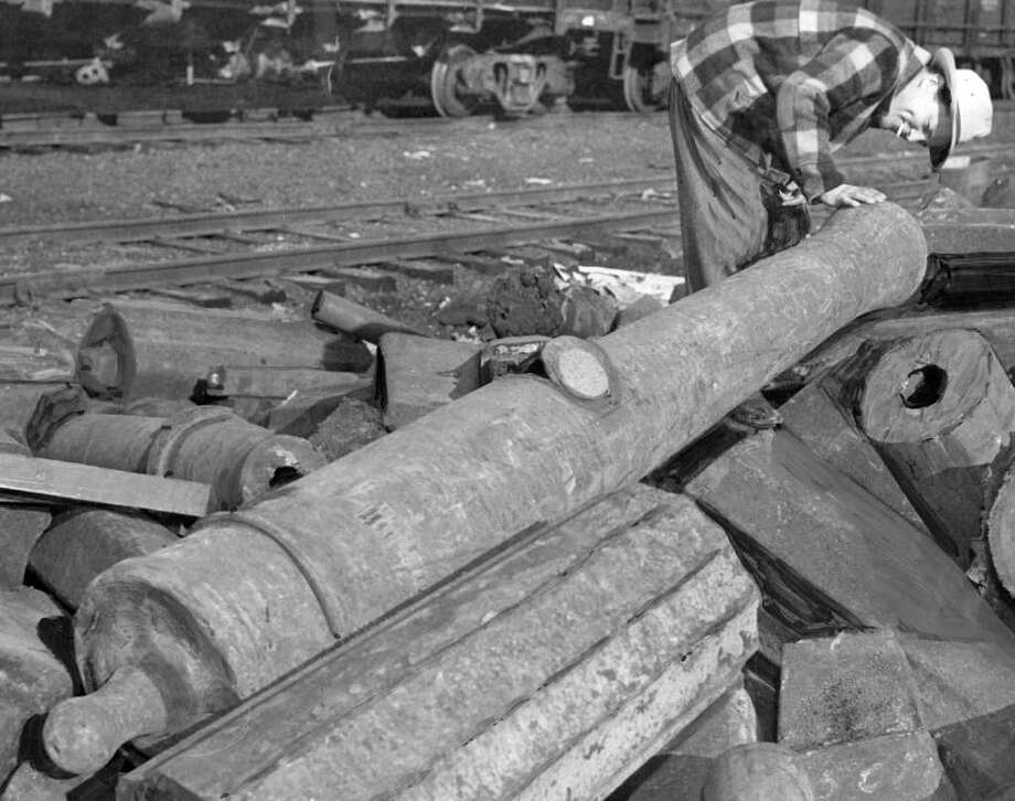 The Feb. 1949 photo caption read: Old Japanese cannon, in scarp pile at recent shipment from Japan, examined by Richard A. Barden, yard foreman, at Bethelhem Steel Corporation. Photo: Seattlepi.com File