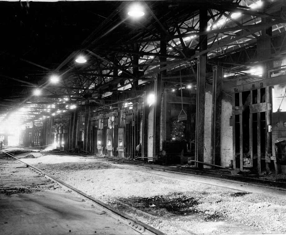The Oct. 1942 photo caption read: Enough steel to manufacture 250 destroyers a year is turned out annually at the Bethlehem Steel Seattle plant, shown here, one of two plants north of San Francisco and west of Colorado. Scrap which goes into these furnaces is all collected from this area and performs a vital war role. Photo: Seattlepi.com File