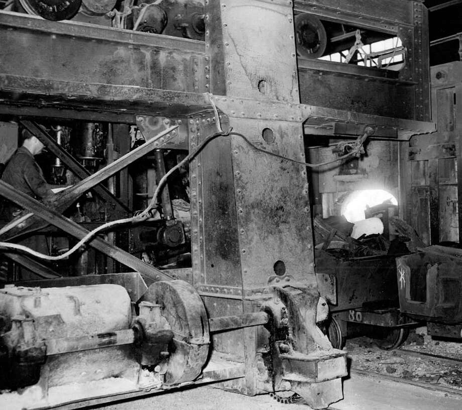 The Oct. 1942 photo caption read: This open hearth furnace, first to be added to the Bethlehem Steel Company's West Seattle plant since 1918, was observed Friday by Chamber of Commerce men who learned that plant now turns out 200,000 tons of steel annually. Photo: Seattlepi.com File