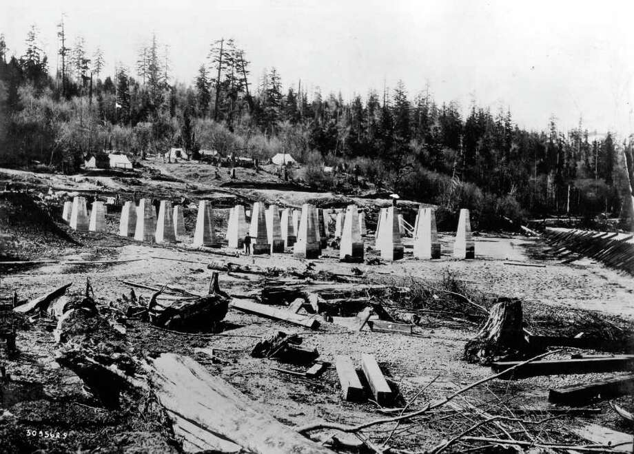 Foundation work in 1904 for the Bethlehem Steel plant. The woods in background are now heavily populated residential area of West Seattle. Photo: Seattlepi.com File