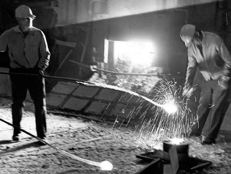 The Sept. 15, 1964 photo caption read: Ingot poured to mark anniversary of steel industry. Photo: Seattlepi.com File