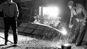 The Sept. 15, 1964 photo caption read: Ingot poured to mark anniversary of steel industry.