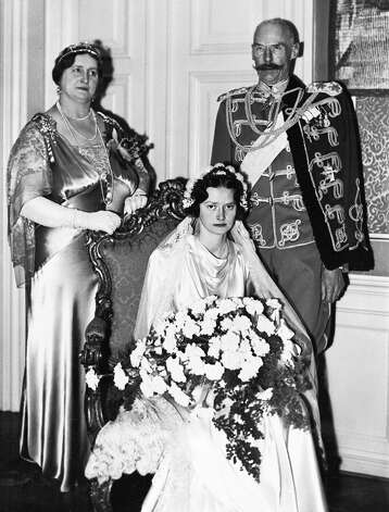 Princess Alexandrine-Louise of Denmark on her wedding day, with her parents Prince Harald and Princess Helena, Castle Christiansborg, Copenhagen, Jan. 22, 1937. (AP Photo)